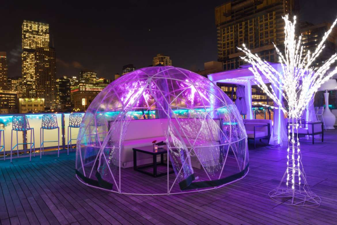 The Godfrey's Rooftop Suits Up With Transparent Igloo Lounges