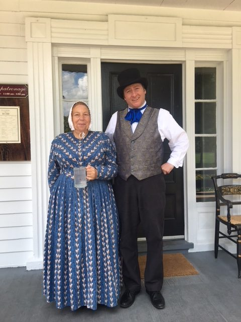 Costumed interpreters waiting to serve you at Eagle Tavern.